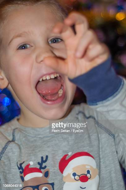 close-up portrait of boy with mouth open - florin seitan stock pictures, royalty-free photos & images