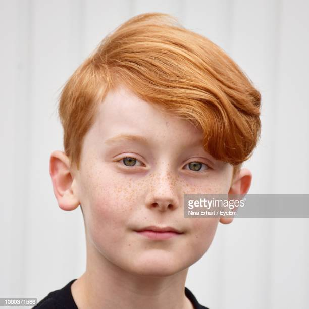 Close-Up Portrait Of Boy With Redhead