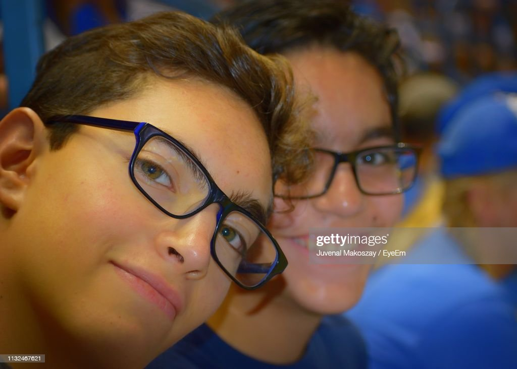 Close-Up Portrait Of Brothers Wearing Eyeglasses : Stock Photo