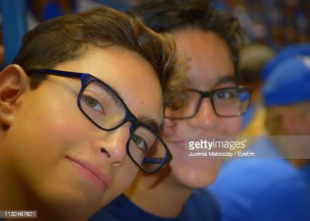 Close-Up Portrait Of Brothers Wearing Eyeglasses