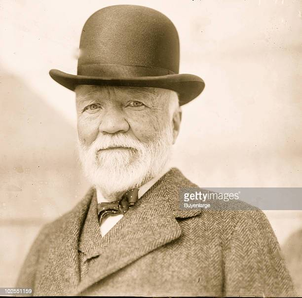 Closeup portrait of businessman and industrialist Andrew Carnegie wearing a bowler hat and bow tie 1912