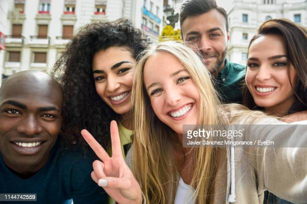 close-up portrait of cheerful friends in city - southern europe stock pictures, royalty-free photos & images