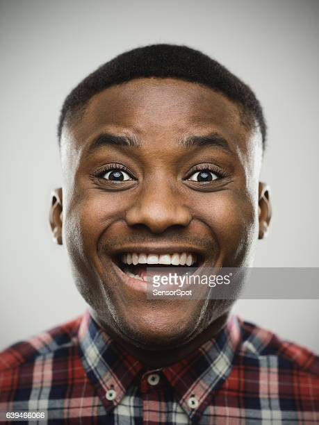 Close-up portrait of cheerful surprised man