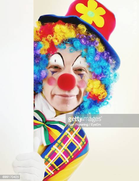 Close-Up Portrait Of Clown Against White Background