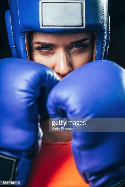 Close-up portrait of confident female boxer