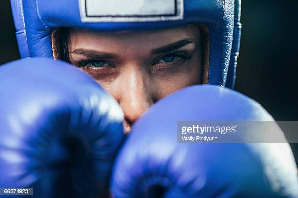 close-up portrait of confident female boxer - purple glove stock pictures, royalty-free photos & images