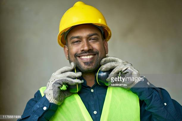 close-up portrait of confident male engineer - ear protection stock pictures, royalty-free photos & images