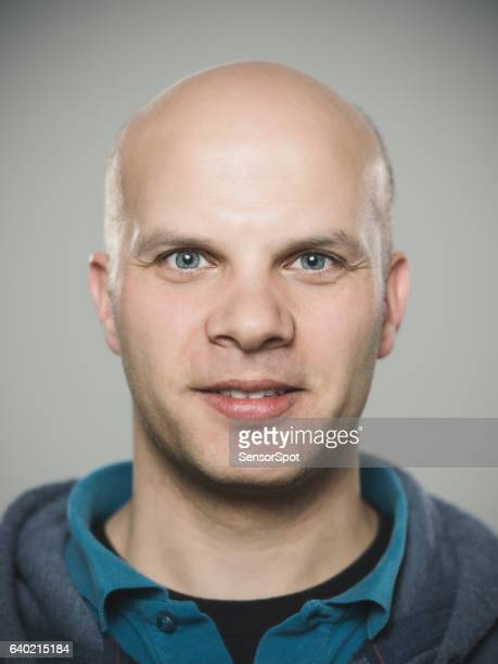 close-up portrait of confident man - completely bald stock pictures, royalty-free photos & images
