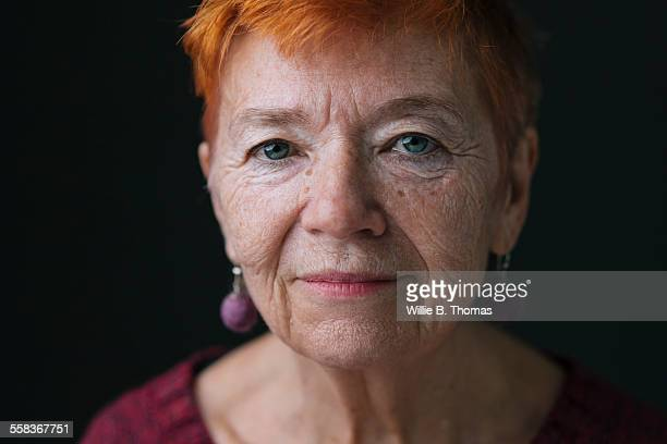 close-up portrait of confident senior woman - older redhead stock pictures, royalty-free photos & images