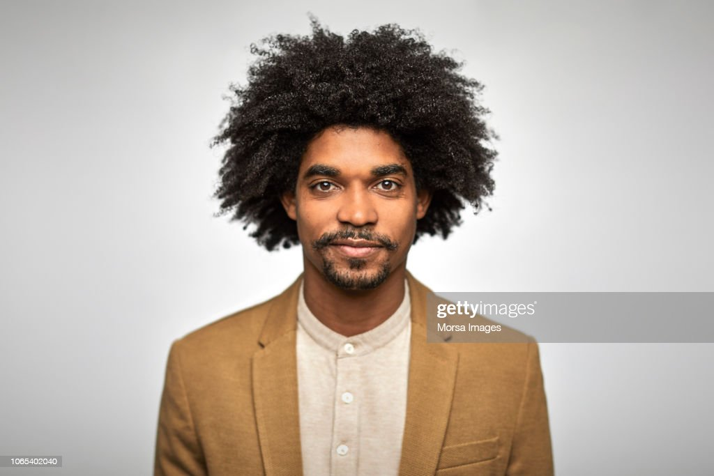 Close-up portrait of confident young businessman : Stock Photo