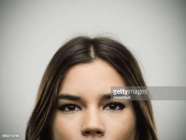 Close-up portrait of confident young woman
