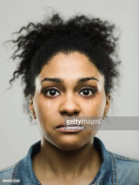 Close-up portrait of crying young afro american woman