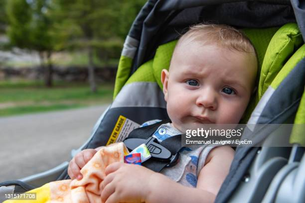 close-up portrait of cute baby girl in park - carriage stock pictures, royalty-free photos & images