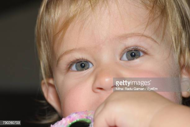 close-up portrait of cute baby girl with gray eyes - grey eyes stock pictures, royalty-free photos & images
