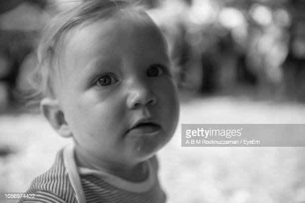 Close-Up Portrait Of Cute Baby Outdoors