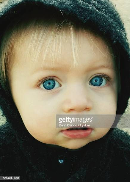Close-Up Portrait Of Cute Baby Wearing Hoodie