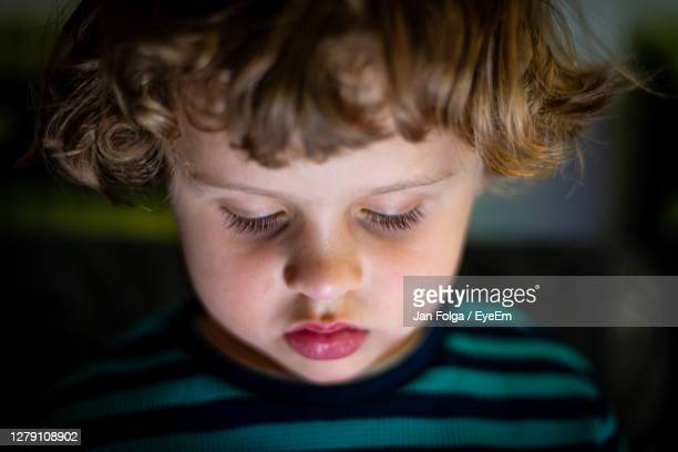 close-up portrait of cute boy screen time - eye stock pictures, royalty-free photos & images
