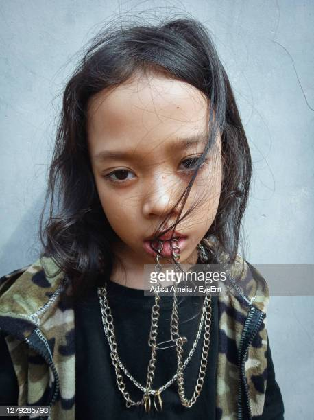 close-up portrait of cute girl against wall - bandung stock pictures, royalty-free photos & images