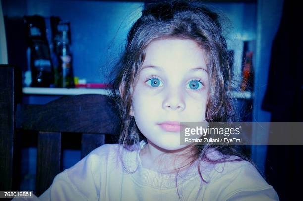 Close-Up Portrait Of Cute Girl At Home