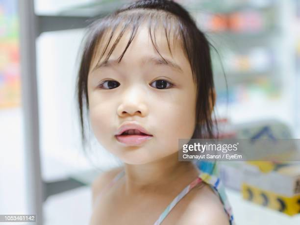 close-up portrait of cute girl - chanayut stock photos and pictures