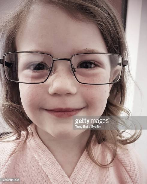 bf466deb1a Closeup Portrait Of Cute Girl Wearing Eyeglasses Stock Photo - Getty Images