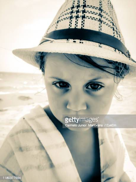 close-up portrait of cute girl wearing hat outdoors - carmelo ストックフォトと画像