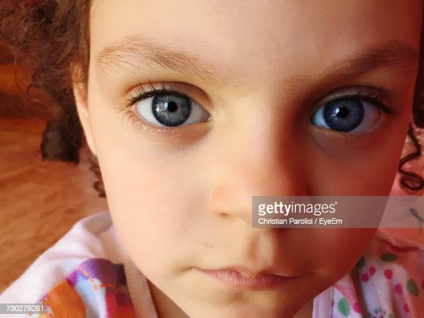 Close-Up Portrait Of Cute Girl With Gray Eyes