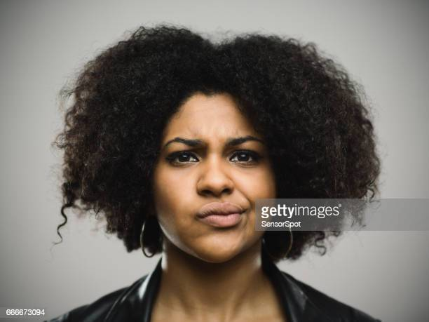 close-up portrait of displeased young afro american woman - frowning stock pictures, royalty-free photos & images