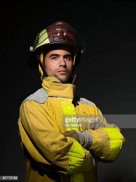close-up portrait of firefighter - firefighter stock pictures, royalty-free photos & images