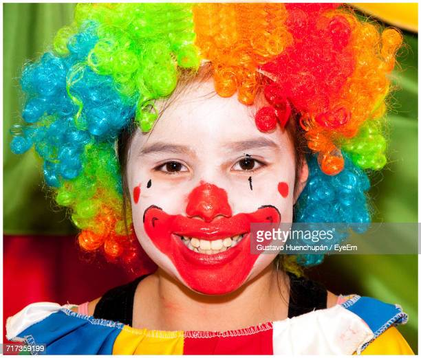 close-up portrait of girl in clown costume - happy clown faces stock photos and pictures