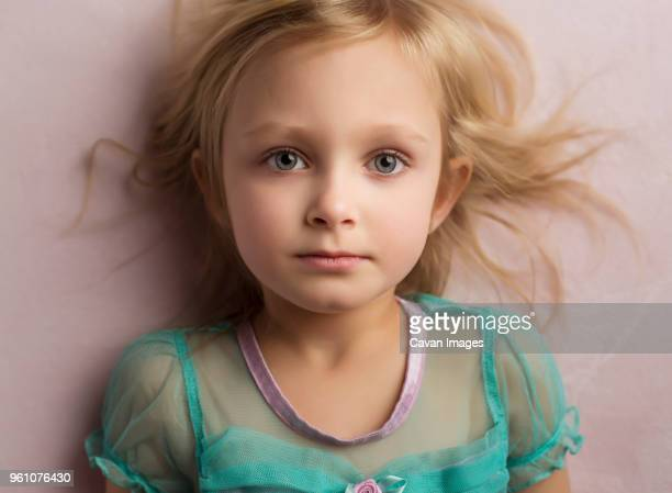 close-up portrait of girl standing by wall at home - grey eyes stock pictures, royalty-free photos & images