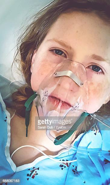 Close-Up Portrait Of Girl Wearing Oxygen Mask