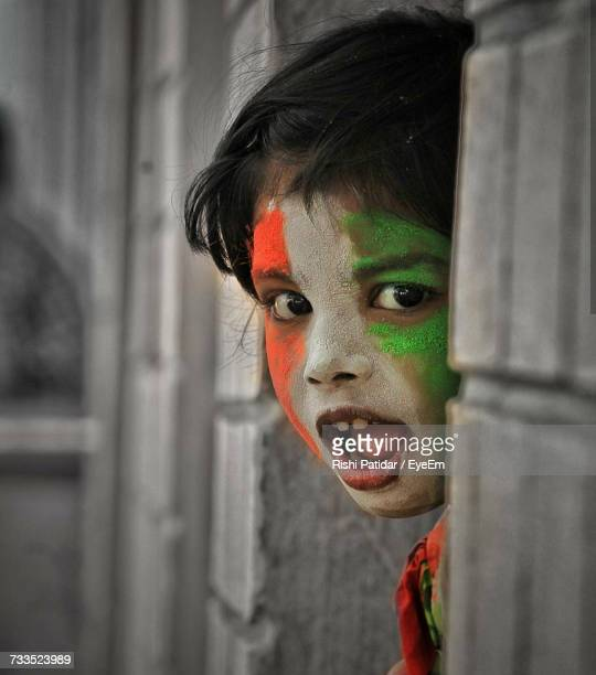 close-up portrait of girl with face paint of indian flag - indian flag stock pictures, royalty-free photos & images