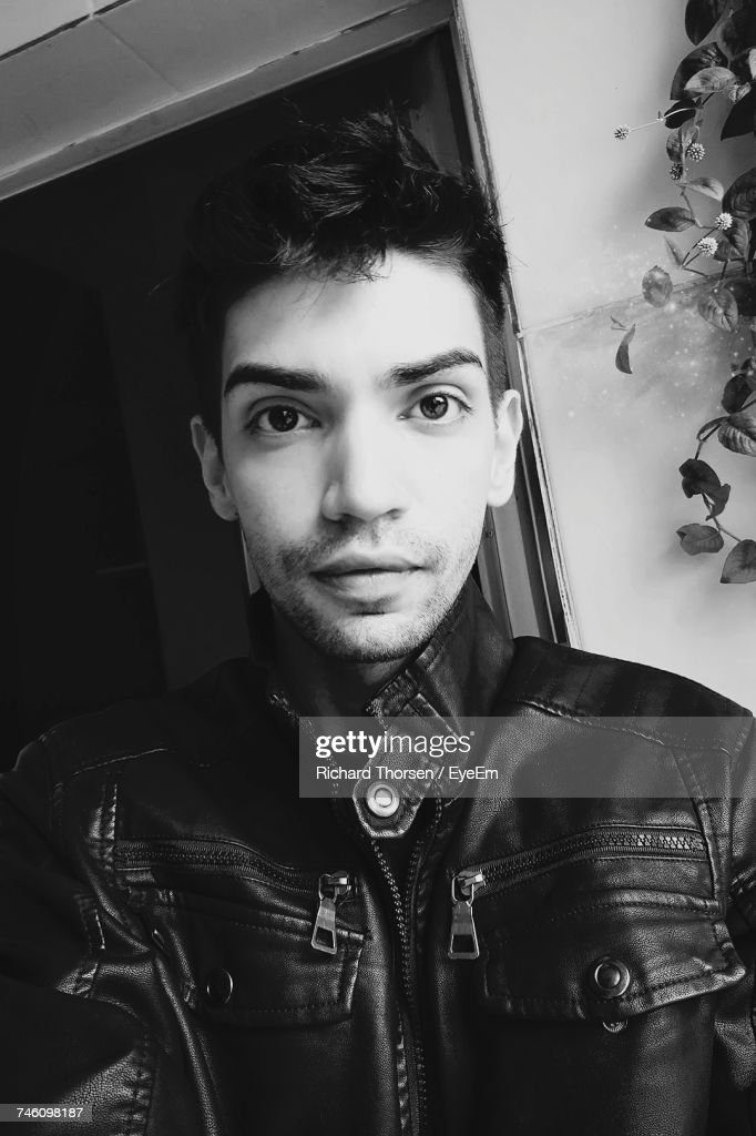 Closeup Portrait Of Handsome Young Man In Leather Jacket Stock Photo