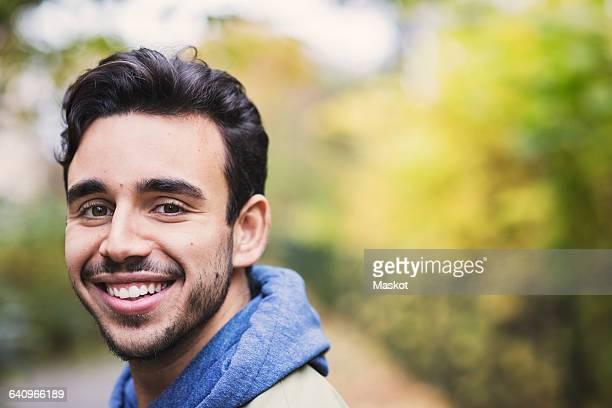 Close-up portrait of happy caretaker outdoors