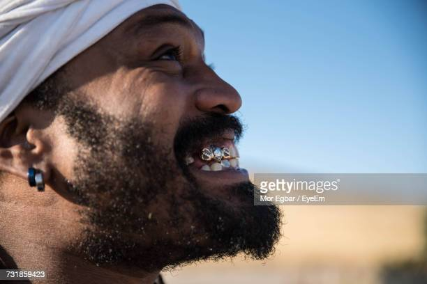 close-up portrait of happy man looking up - gold tooth stock photos and pictures
