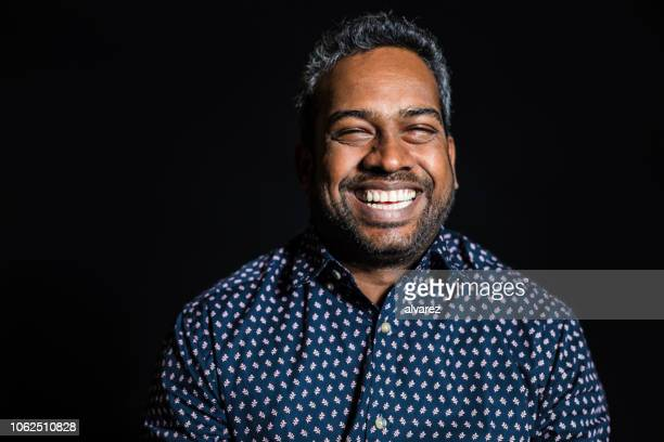 close-up portrait of happy mid adult man - black background stock pictures, royalty-free photos & images