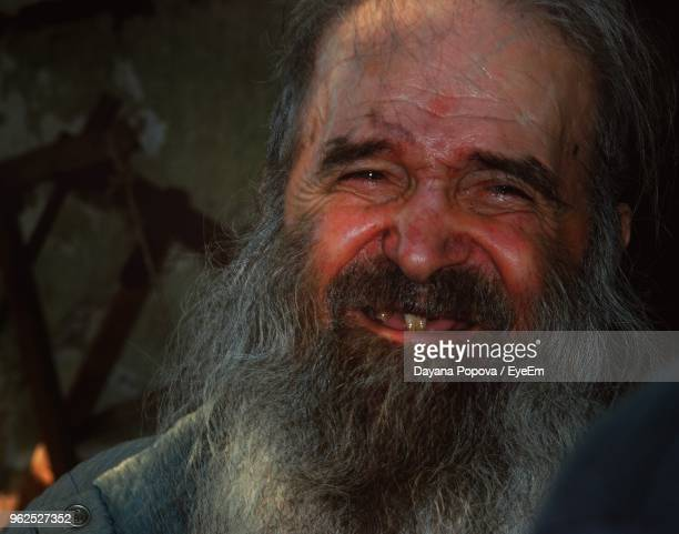 close-up portrait of happy senior man - missing teeth stock photos and pictures