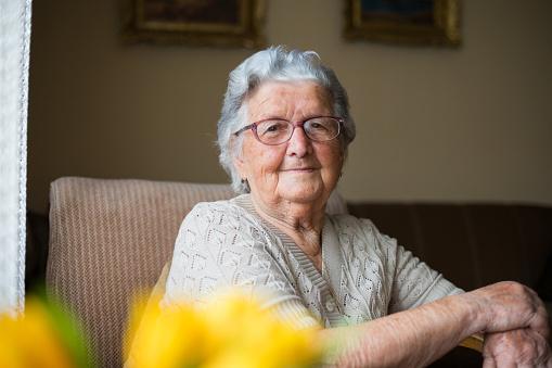 Close-up portrait of happy senior woman portrait 1150346585