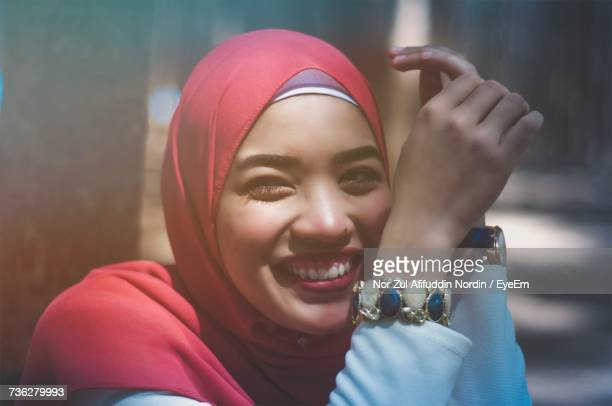 Close-Up Portrait Of Happy Young Woman Wearing Hijab