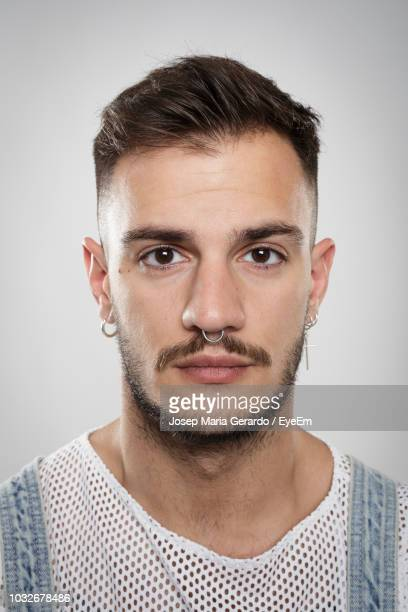 Close-Up Portrait Of Hipster Man Against White Background