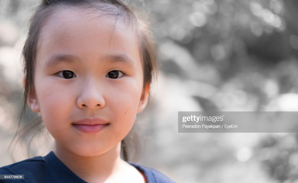 Close-Up Portrait Of Innocent Girl : Stock Photo