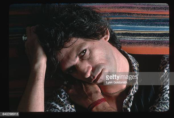 1981 Closeup portrait of Keith Richards guitarist for the British rock roll band The Rolling Stones He wears a leopardprint shirt and holds his head...