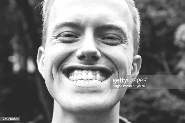 close-up portrait of man clenching teeth - clenching teeth stock pictures, royalty-free photos & images