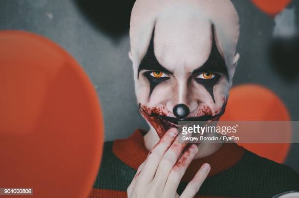 close-up portrait of man dressed as clown - scary clown makeup stock photos and pictures