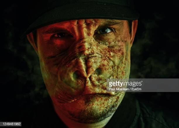 close-up portrait of man in gorilla hybrid make-up. with blood on face - horror movie stock pictures, royalty-free photos & images