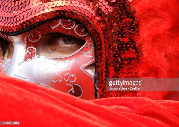 Close-Up Portrait Of Man In Red Venetian Mask