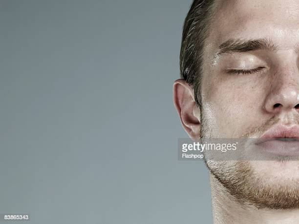 close-up portrait of man - eyes closed stock pictures, royalty-free photos & images