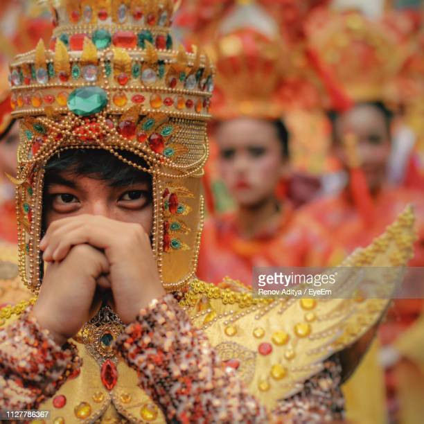 close-up portrait of man wearing costume during traditional festival - jakarta stock pictures, royalty-free photos & images