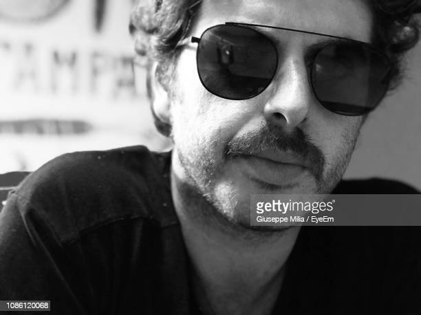 close-up portrait of man wearing sunglasses - province of caltanissetta stock photos and pictures